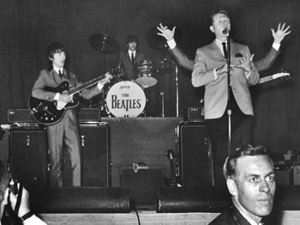 John Lennon behind Red Robinson, Brian Epstein lower right